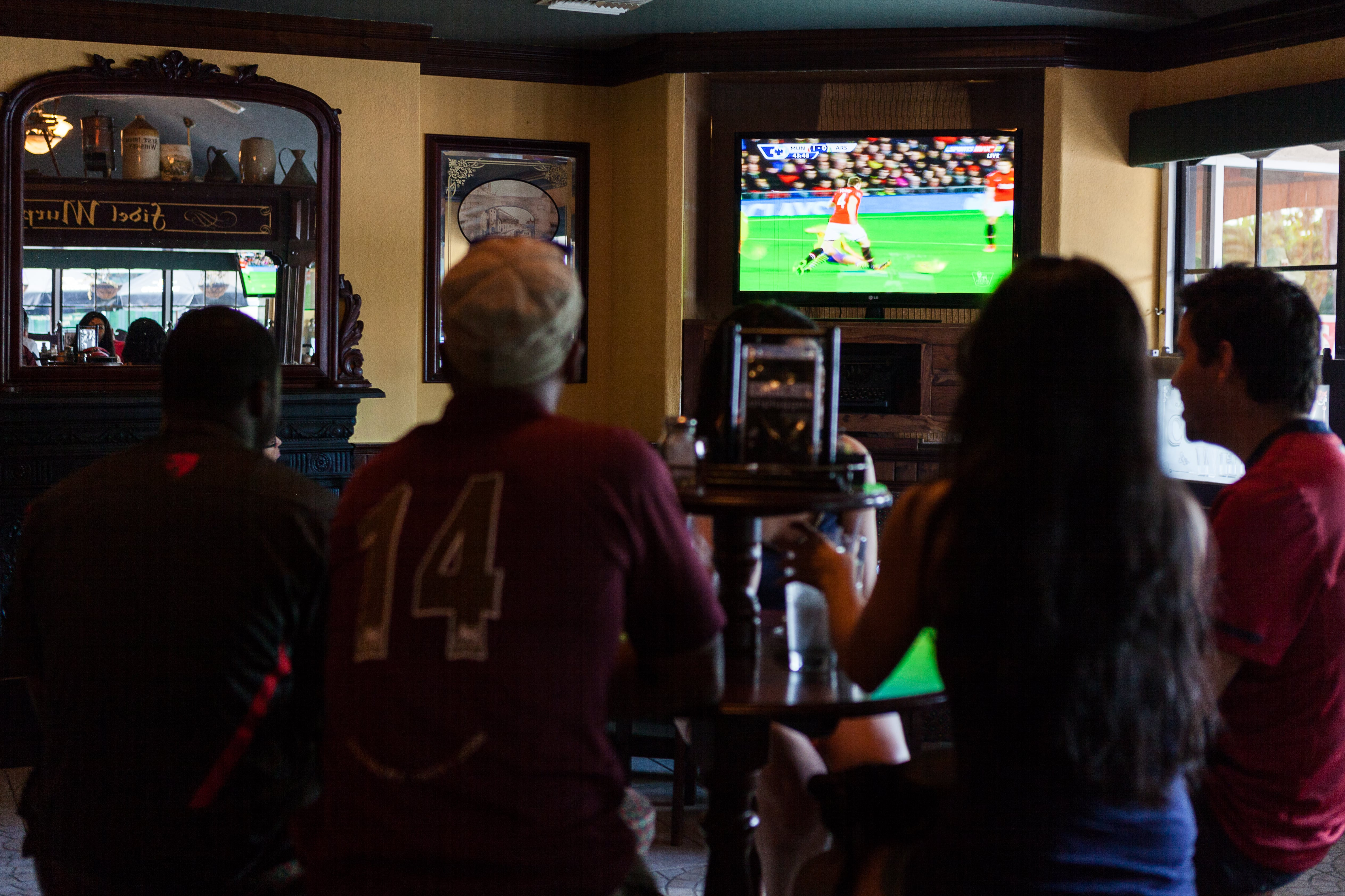 Fidels Cayman Watching a Football Game