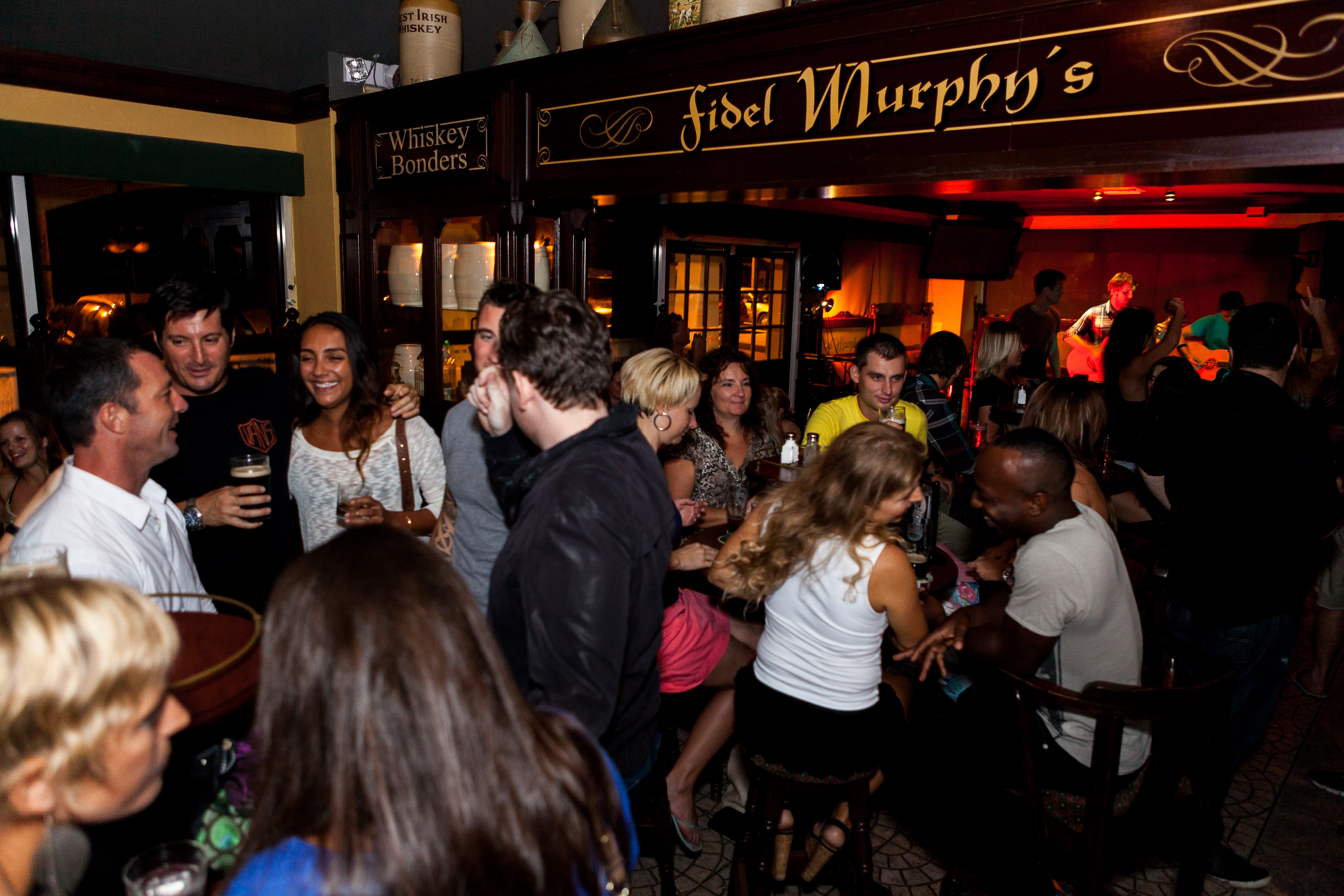 People Socialising at Fidels Cayman Bar