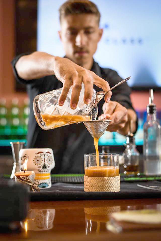 Karoo Cayman Employee Making  A Cocktail