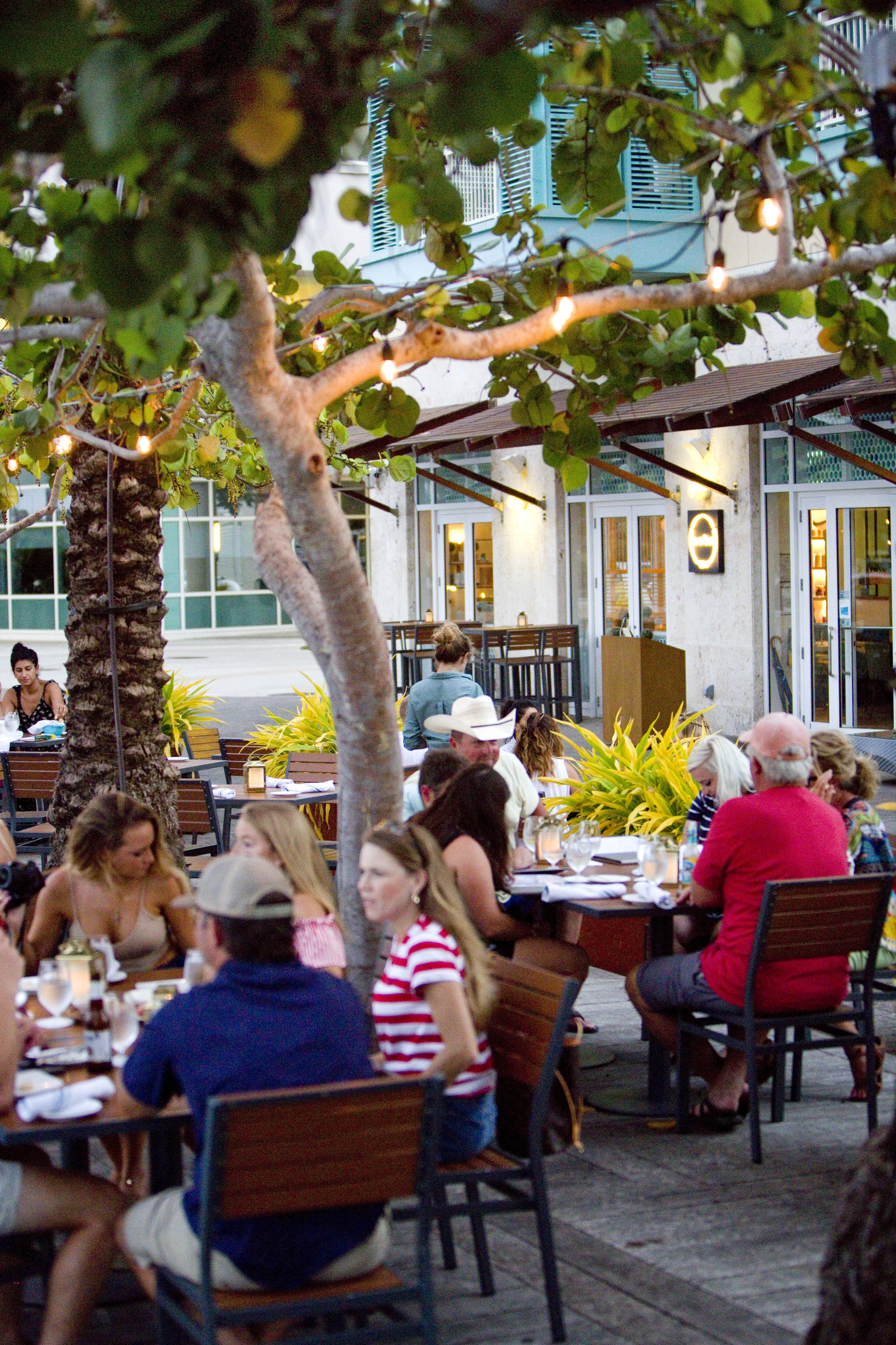 People eating outside of Agua Cayman