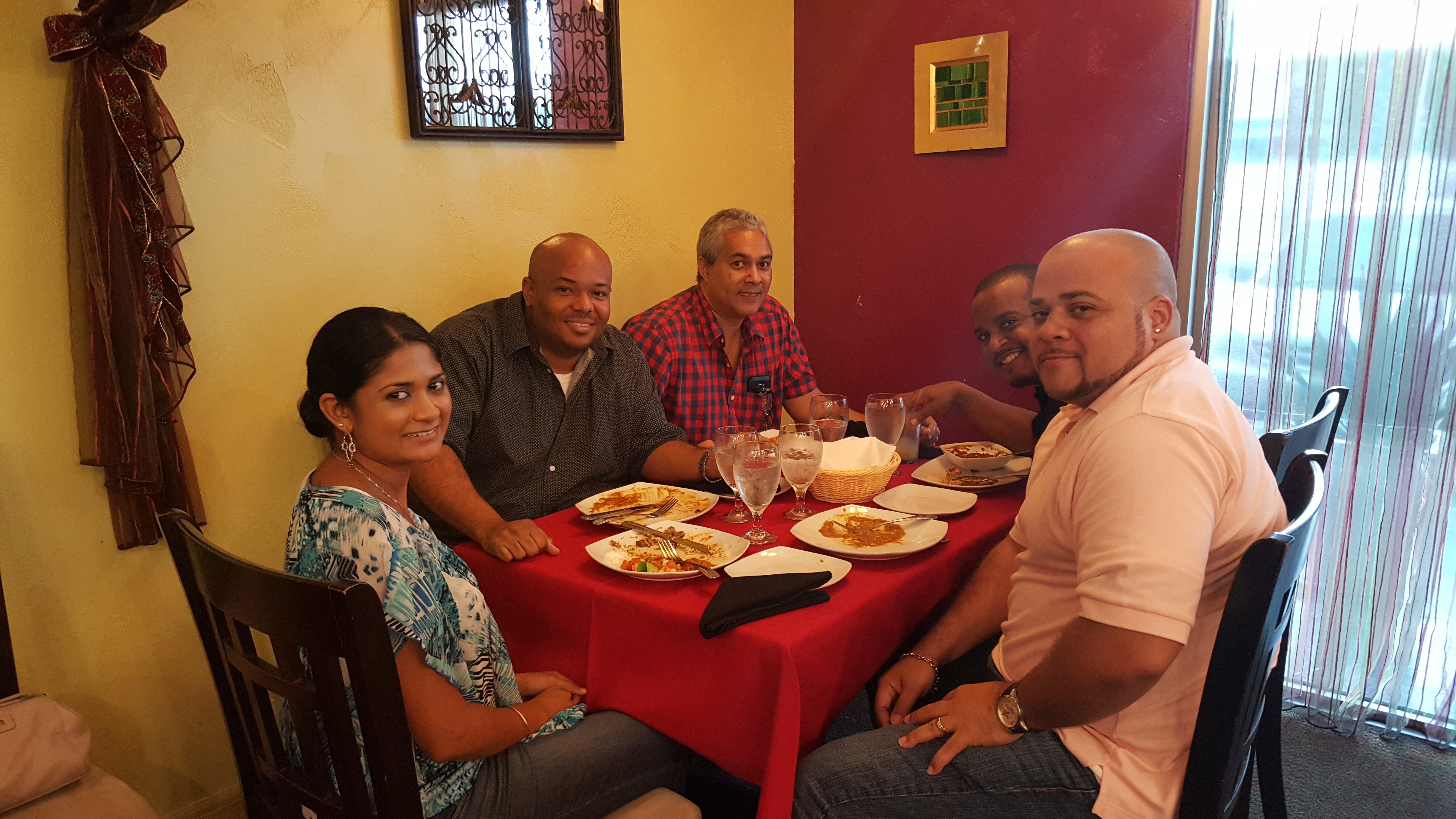 Family Around a Table at Southern Spice