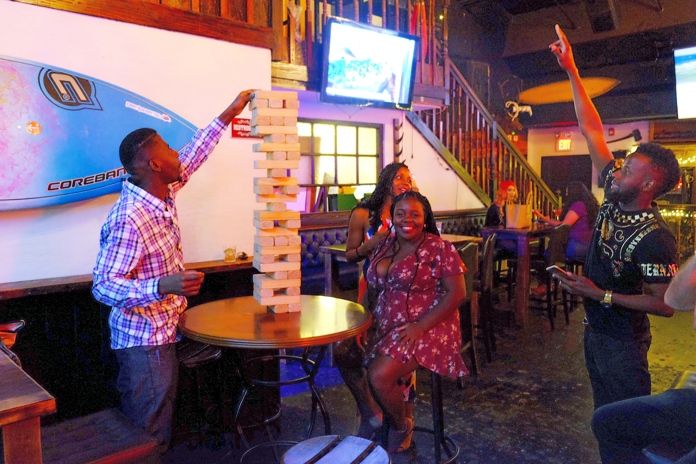 People Playing Games at The Lodge Cayman Bar